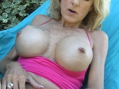 Big tits blonde in solo action outdoors