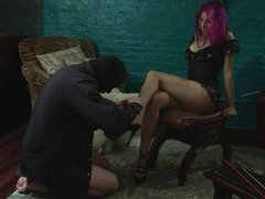 Slave licking his mistresses feet