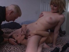 Mature lesbo in action with a younger chick