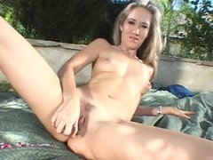Blonde in heat masturbating outdoors