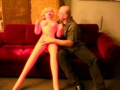 Horny dudes playing with a doll