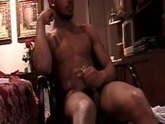 Black thug masturbates to porn