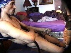 Ebony stud massaging his cock