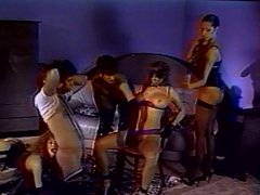 Couple controlled by lesbian dominatrixes