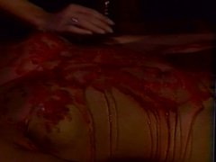 Naked Asian chick covered in hot wax
