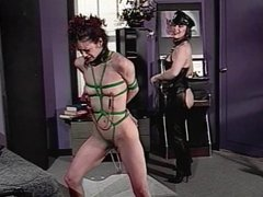 Leather dyke strips and humiliates sub bitch