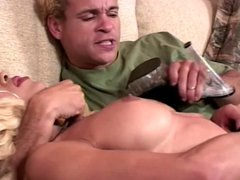 Blonde tranny with a decent rack in action with a guy