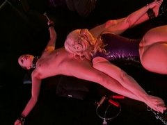 Nina Hartley enjoying a bondage session with a cute slave