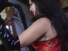 Lesbian mistress toys with her bound sex slave