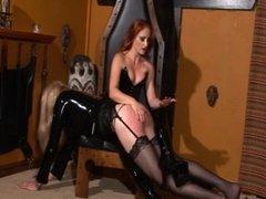Redhead mistress spanks an ultra-tall skinny blonde