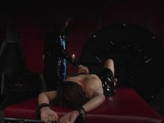 Slut placed in metal cuffs and spanked