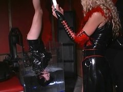 Leather clad submissive woman hung upside down