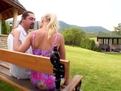 Blonde shows tits and pussy on public bench