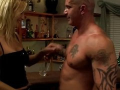 Cute blonde with an amazing rack blows a lucky guy by the bar
