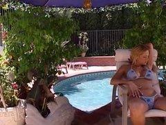 Blonde enjoying cock at pool side