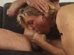 Busty blonde whore getting cock to suck on
