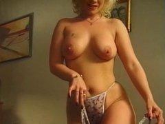 Busty blonde whore takes anal pounding on toilet