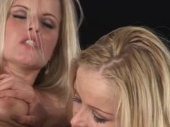 Two busty blondes have lesbian fun on the kitchen