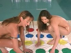 Busty brunettes have wild twister fun by pool