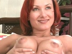 Horny redhead rubs her nipples and squeezes her boobs
