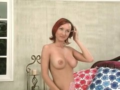 Horny redhead deep throats herself with her dildos