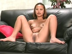Sexy chick spreads her legs on the couch