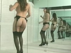 Busty brunette strips in front of mirror