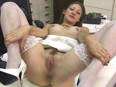 Sexy brunette secretary fingers her wet pussy
