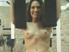Gorgeous young brunette shows off her fit flexible body at the gym