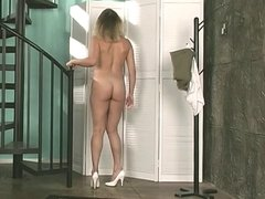 Hot blonde strips to reveal lovely body near the stairs