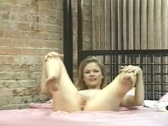 Sexy horny blonde stripteases in bedroom alone