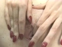 Horny bitch gets two fingers in her horny pussy
