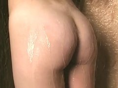 Hot whore with curly hair plays with tits in shower