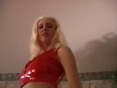 Sexy blonde in red latex takes some punishments