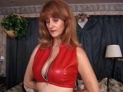 Mature big tits brunette in red latex, bound & enjoying her BDSM session
