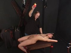 Small tits hottie bound & teased with wax by her master
