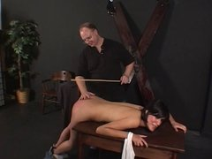 Hot brunette spanked hard by her master