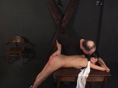 Hot brunette bends over for a spanking session