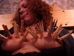 Big tits redhead has her tits covered with clothes pegs