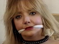 Cute blonde bound, gagged and teased by her master