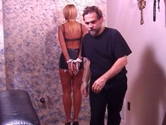 Big tits hottie in leathers, bound and gagged for a BDSM session