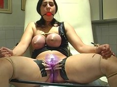 Dark-haired slave gets hot wax on her pussy