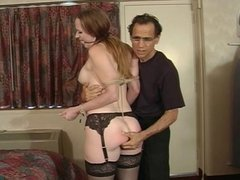 Julie Simone in nylons gets her big tits teased by her master