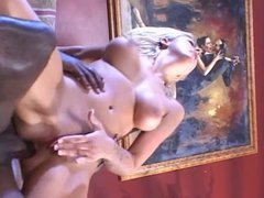 Blonde sucks long black cock on sofa