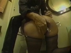 Luring lady in latex dress is fucked in toilet