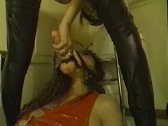 Two babes play with dildo in bathroom