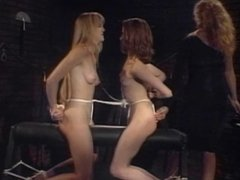 Dominant chick uses bondage on two girls