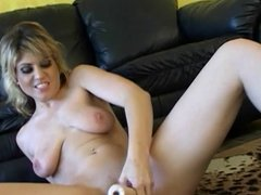 Sexy blonde strips and dildos herself on the floor