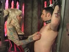 Dude in bondage obeys orders from blonde dominatrix