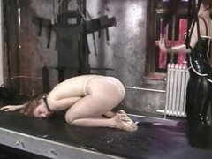 Sizzling redhead in rubber tortures horny girlfriend